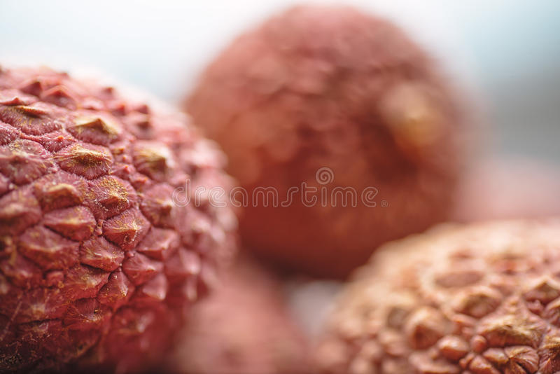 Lichee on wooden table, litchi, lychee fruit detail royalty free stock images