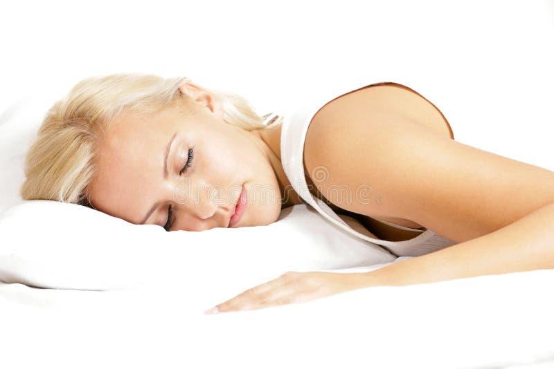 Licht haar vrouwelijk model, die op het hoofdkussen slapen stock afbeeldingen