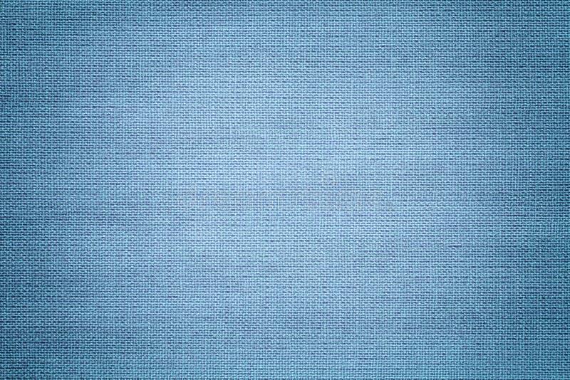 Lichtblauwe achtergrond van een textielproduct Stof met natuurlijke textuur achtergrond royalty-vrije stock afbeelding
