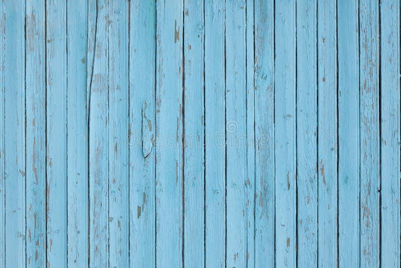 Lichtblauwe gekleurde verticale houten plankentextuur als achtergrond stock foto