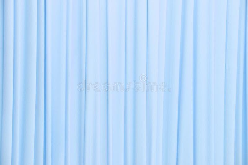 Lichtblauwe gordijntextuur stock foto. Afbeelding bestaande uit ...