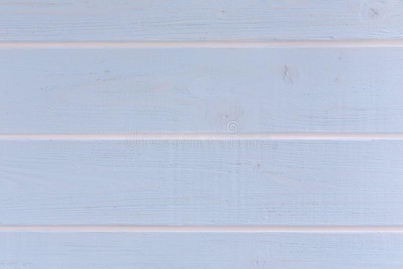 Lichtblauwe houten achtergrond met witte strepen royalty-vrije stock fotografie