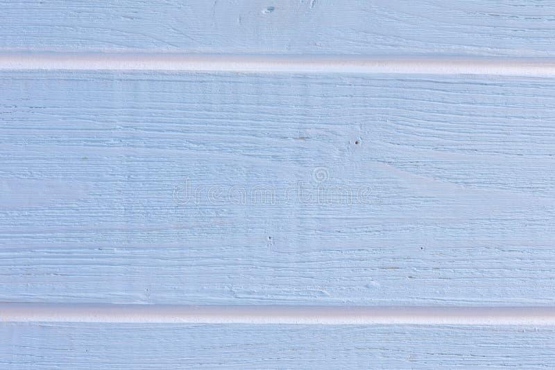 Lichtblauwe houten achtergrond met witte strepen stock afbeelding