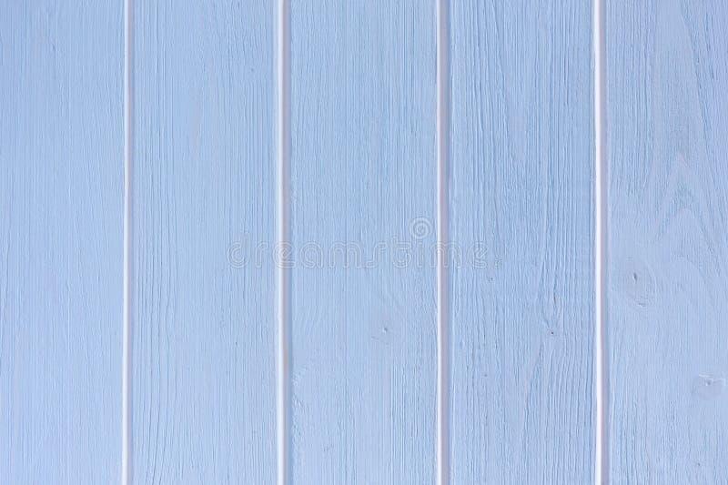 Lichtblauwe houten achtergrond met witte verticale strepen royalty-vrije stock foto