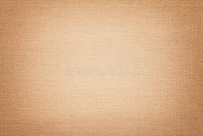 Lichtbruine achtergrond van een textielproduct met rieten patroon, close-up stock afbeelding