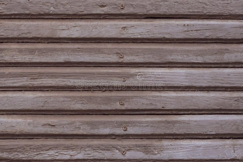 Lichtbruine en grijze houten textuurachtergrond Grijze geschilderde houten planken met spijkers Sjofele lichtbruine houten omhein royalty-vrije stock afbeelding