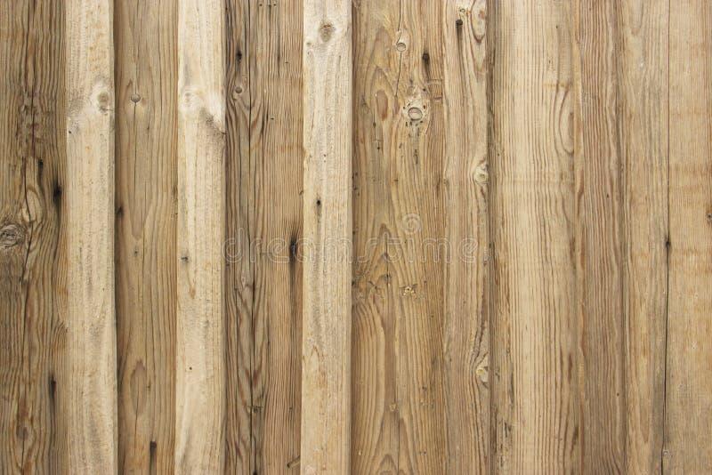 Lichtbruine houten textuur Lichte oude houten panelen als achtergrond De raad wordt verticaal genageld stock afbeeldingen