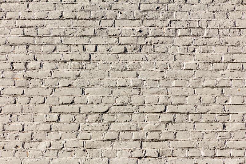 Lichte beige echte bakstenen muur met ongelijk metselwerk Textuur en achtergrond voor decoratie en ontwerp stock fotografie