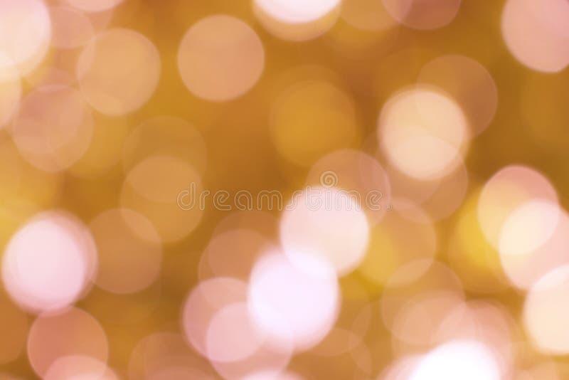 Lichte gouden achtergrond stock afbeelding