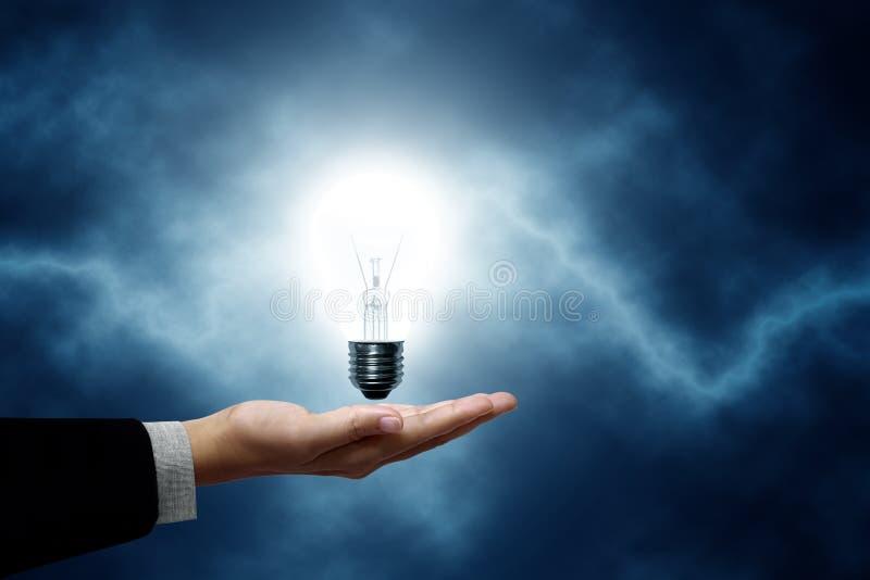 Lichte in hand van de bol, mens. stock afbeelding