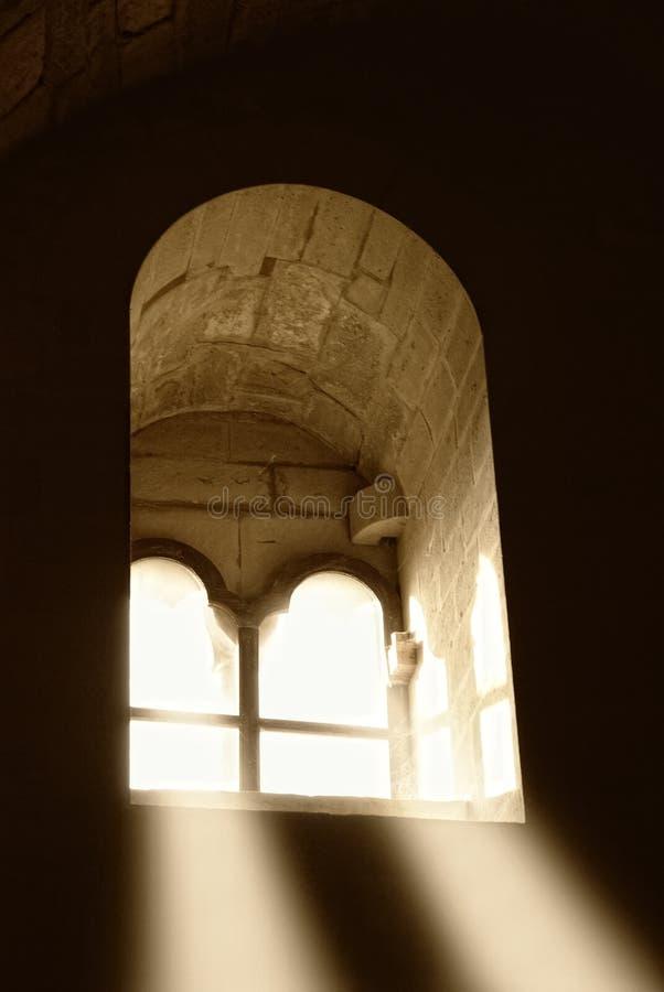 Lichte komst door het venster stock afbeelding