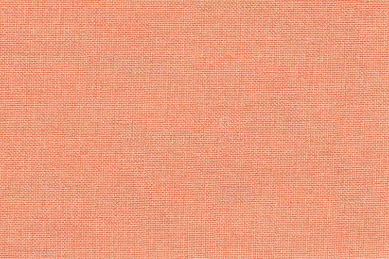 Lichte koraalachtergrond van een textielproduct met rieten patroon, close-up stock fotografie