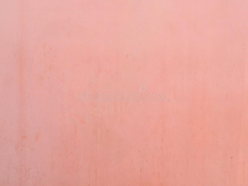Lichte pastelkleur roze verf op de textuurachtergrond van de cementmuur royalty-vrije stock fotografie