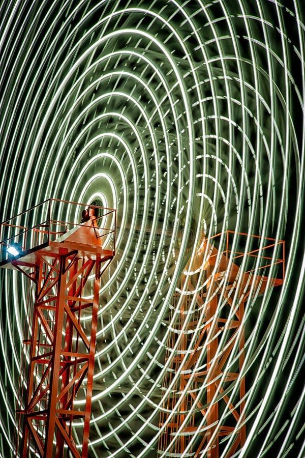 Lichte slepen op Ferris Wheel stock fotografie