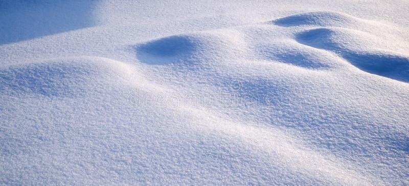 Lichten en schaduwen op de sneeuw stock fotografie