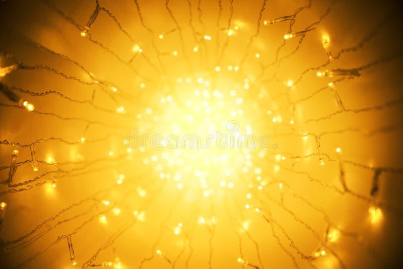 Lichtenslinger, Abstracte Vage Geleide Lichtoranje Verlichting Bokeh stock afbeelding