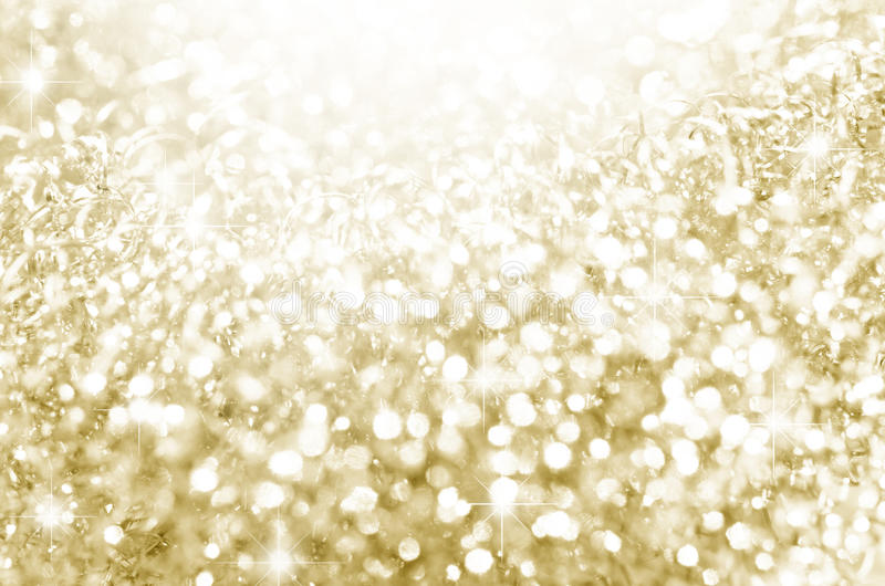 Lichter auf Gold mit Stern bokeh lizenzfreie stockfotografie