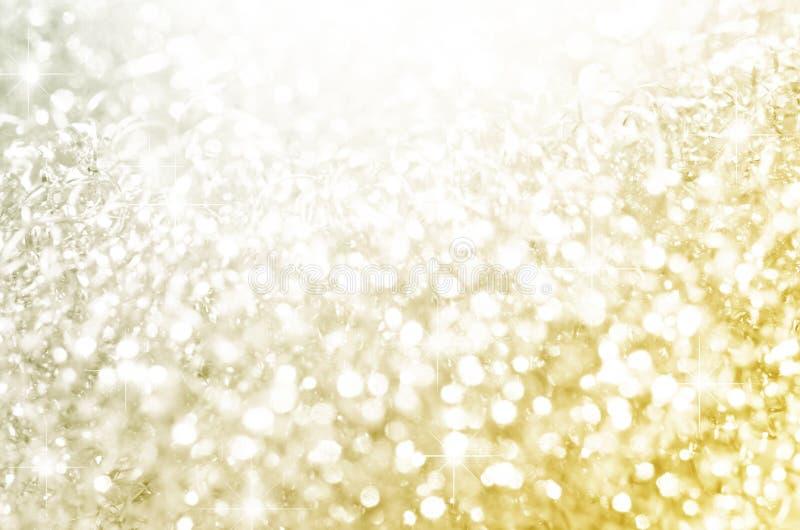 Lichter auf Gold mit Stern bokeh lizenzfreie stockfotos
