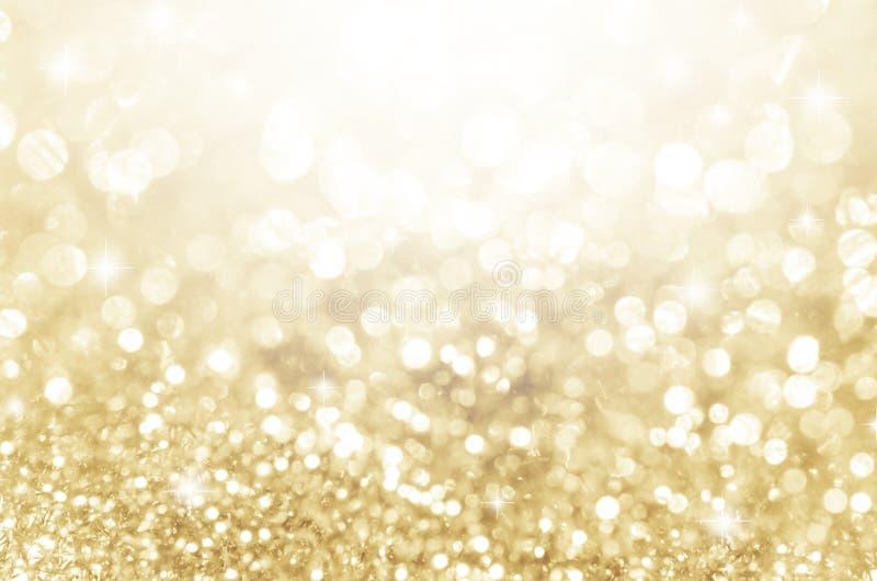 Lichter auf Gold mit Stern bokeh Hintergrund lizenzfreie stockbilder