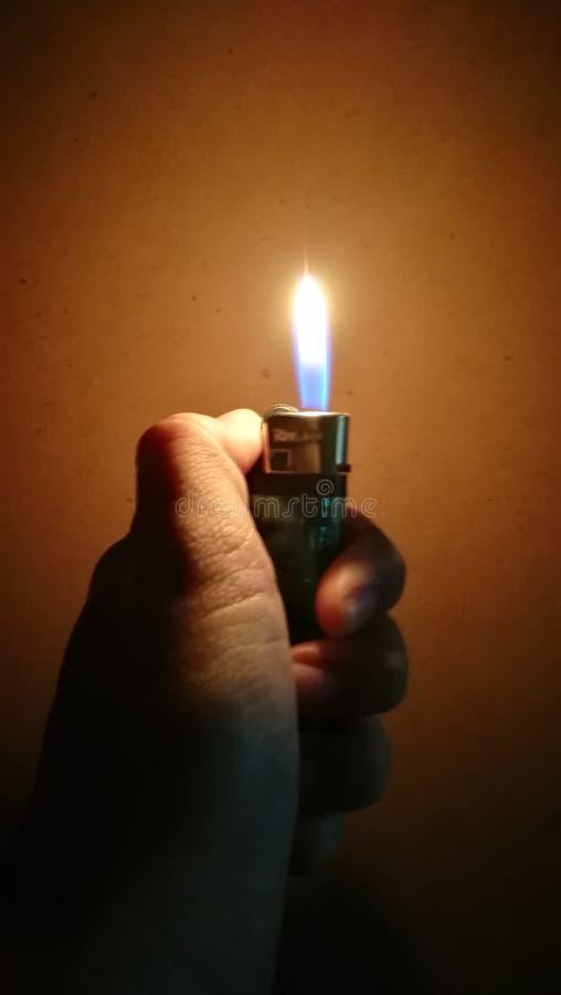 Lichtere in hand stock fotografie