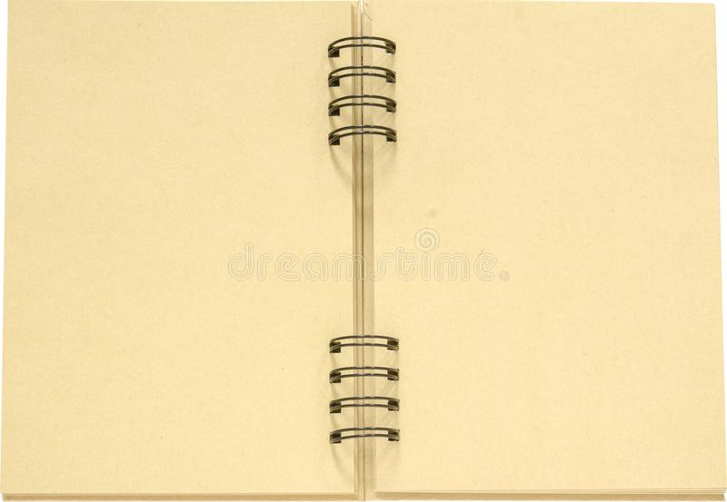 Lichtgeele blanco pagina's in een geïsoleerd notitieboekje royalty-vrije stock fotografie