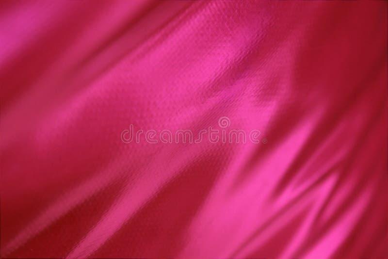 Lichtgewichttextuur van de ruwe donkere roze kleur van de huiddoek stock afbeelding
