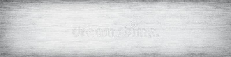 Lichtgrijze metaaloppervlakte Zilveren metaaltextuur Wijd lange witte achtergrond stock afbeelding