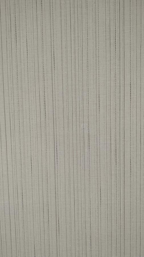 Lichtgrijze stof, patroon met verticale strepen achtergrondclose-up Close-up royalty-vrije stock foto