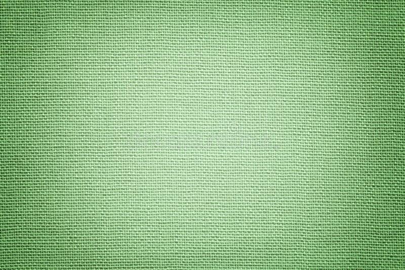Lichtgroene achtergrond van een textielproduct Stof met natuurlijke textuur achtergrond royalty-vrije stock afbeelding