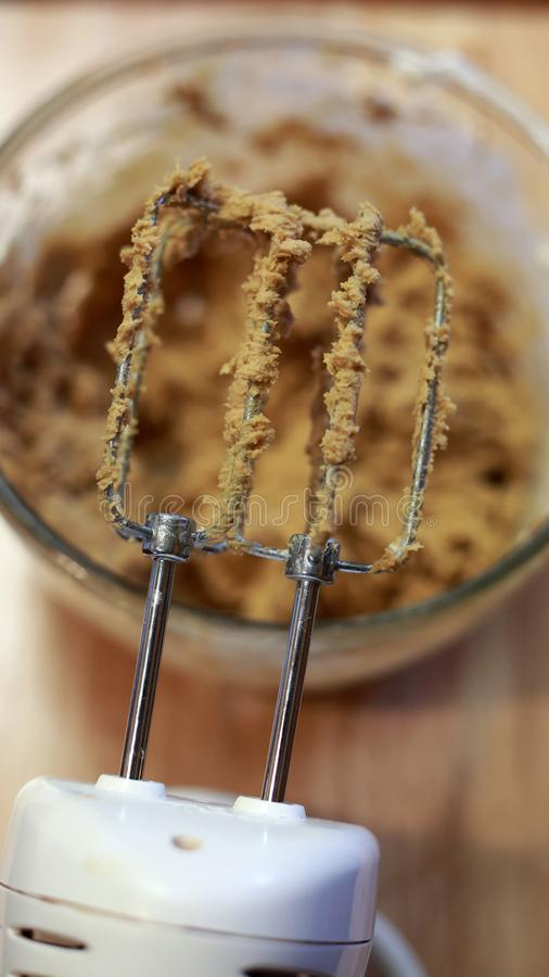 Lick the beaters! Cookie dough. stock photos