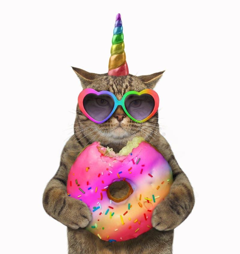 Licorne de chat avec un beignet photos stock