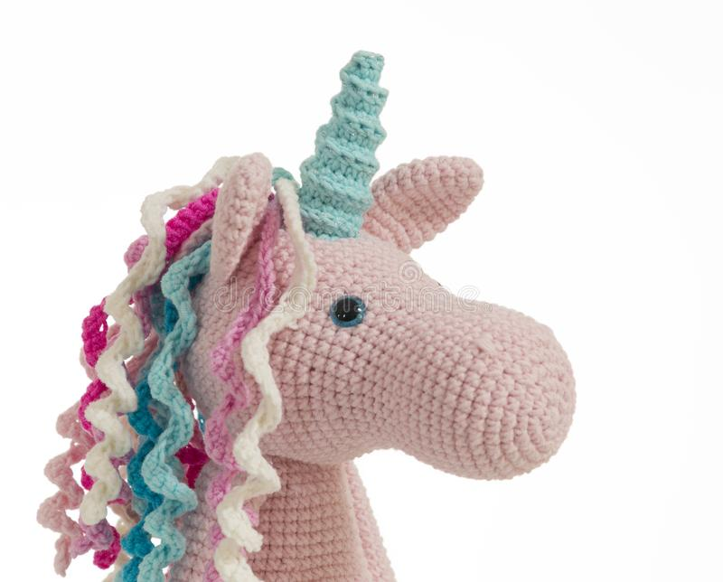 Licorne mignonne de crochet de position de rose photos libres de droits