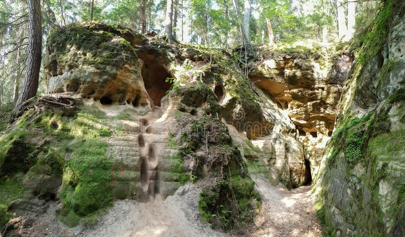 Licu Langu Sandstone Cliffs. The Big Langu Cave. Sand Formations at Lode. Behind Cesis in Latvia royalty free stock photos