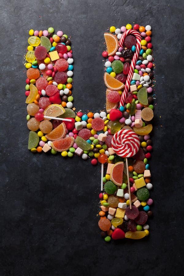 Liczba cztery zrobił od cukierków zdjęcie stock