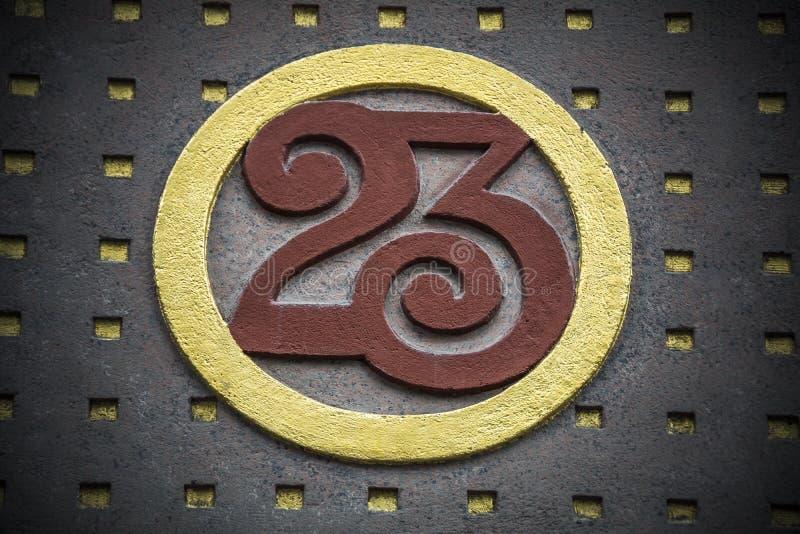 Liczba dwadzieścia trzy z złocistą i czerwoną dekoracją zdjęcia royalty free