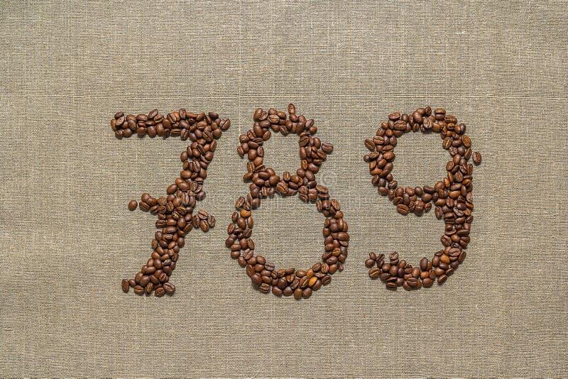 Liczby siedem, osiem, dziewięć od kawowych fasoli zdjęcia royalty free