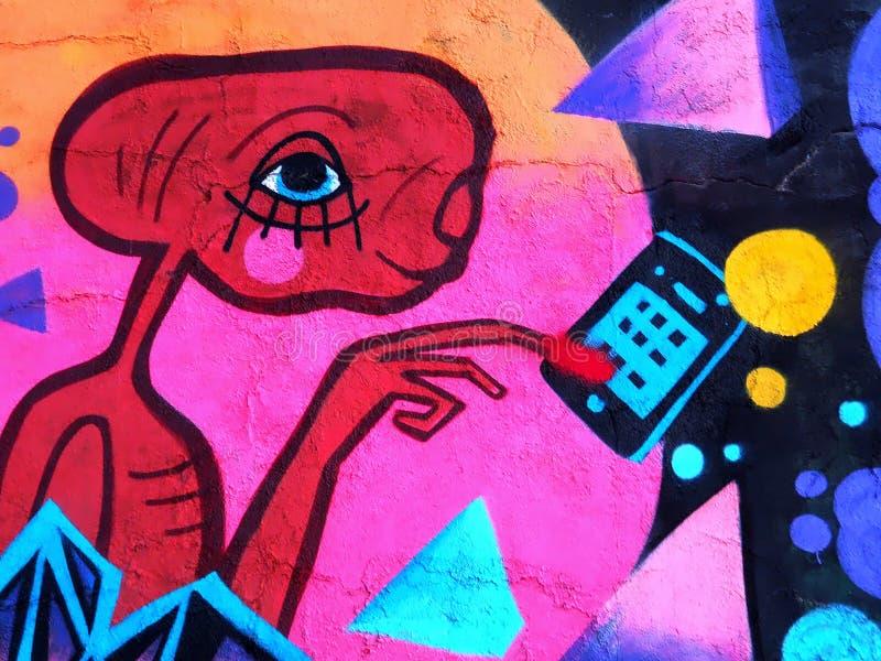 ?liczni graffiti s?awny E T telefonowa? do domu zdjęcia royalty free