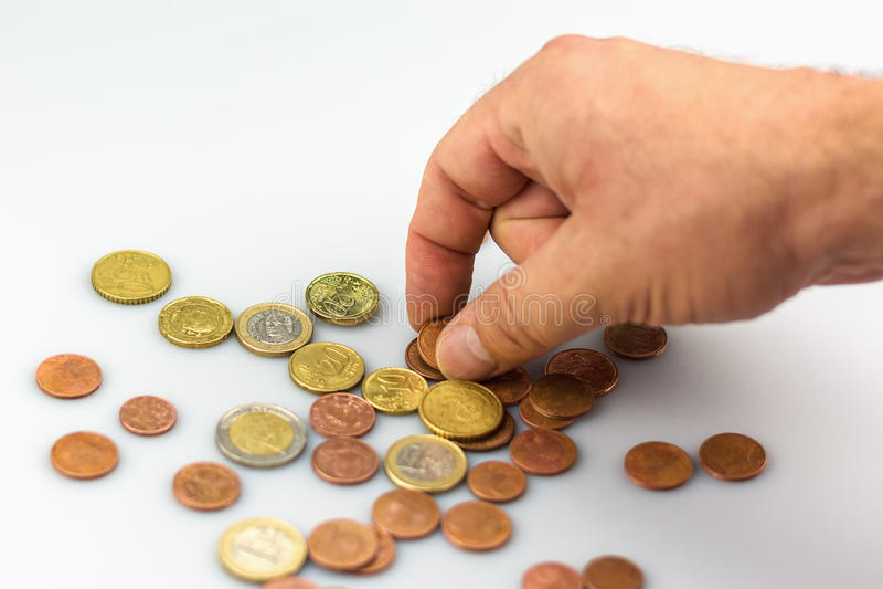 Liczyć monety ręką obrazy stock