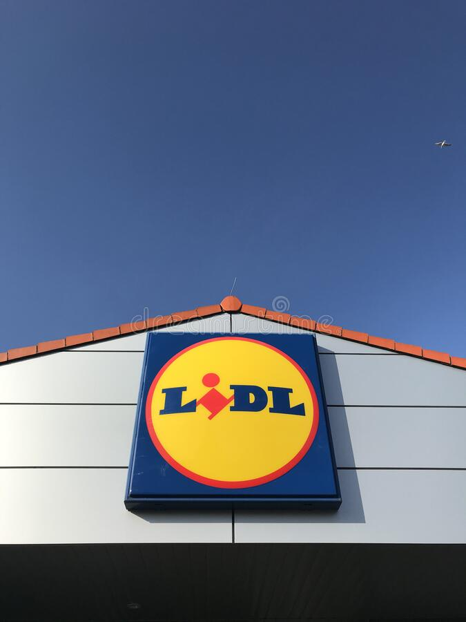 Lidl store sign with blue sky stock photos