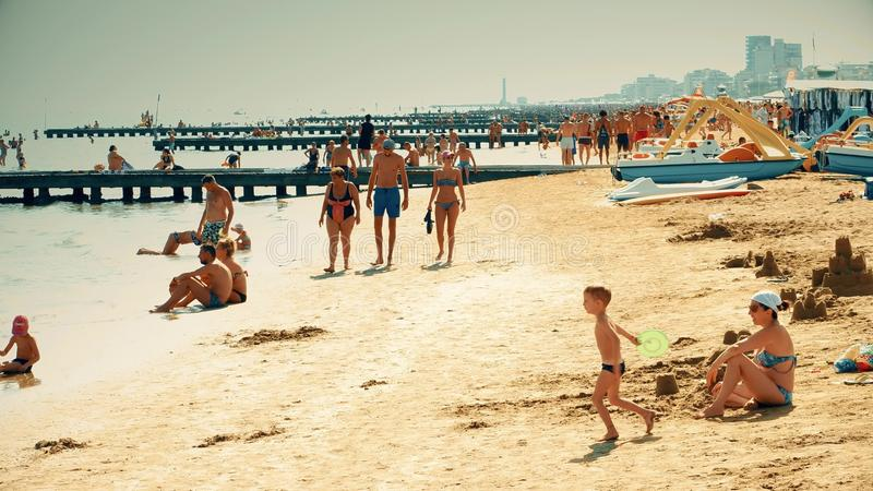 LIDO DI JESOLO, ITALY - AUGUST 8, 2017. Big crowded sandy beach. Summer vacation time. LIDO DI JESOLO, ITALY - AUGUST 8, 2017 Crowded sandy beach royalty free stock photos