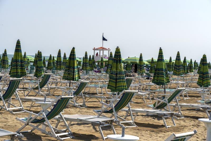 LIDO DI JESOLO, ITALY - May 24, 2019 : Umbrellas on the beach of Lido di Jesolo at adriatic Sea in a beautiful summer day, Italy. On the beach of Lido di stock images