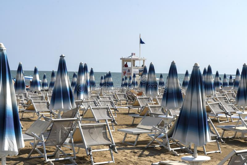 LIDO DI JESOLO, ITALY - May 24, 2019 : Umbrellas on the beach of Lido di Jesolo at adriatic Sea in a beautiful summer day, Italy. On the beach of Lido di royalty free stock photos