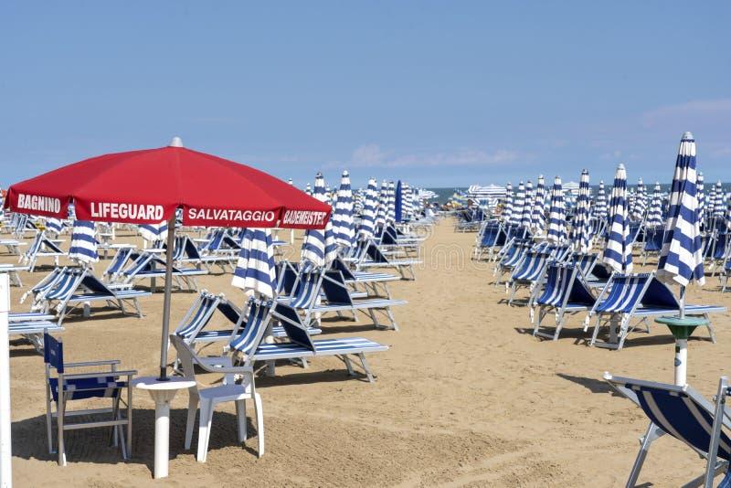 LIDO DI JESOLO, ITALY: Umbrellas on the beach of Lido di Jesolo at adriatic Sea in a beautiful summer day, Italy. On the beach of. Lido di Jesolo near Venice stock image