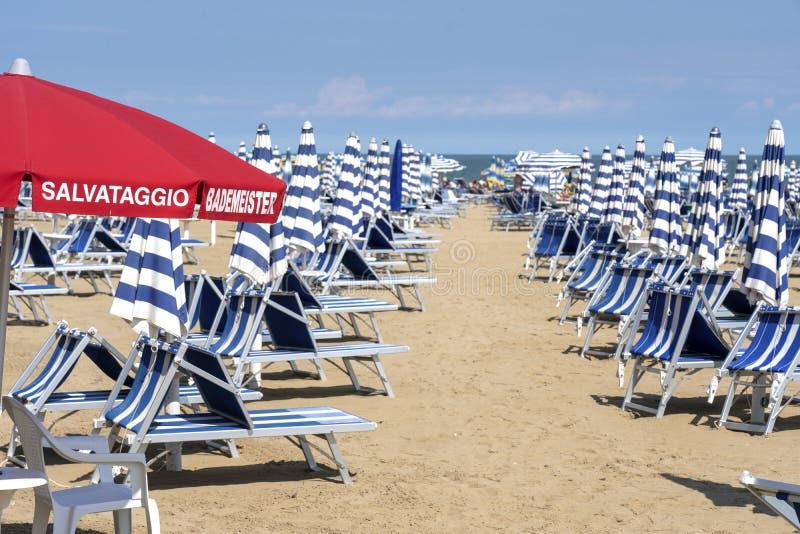 LIDO DI JESOLO, ITALY: Umbrellas on the beach of Lido di Jesolo at adriatic Sea in a beautiful summer day, Italy. On the beach of. Lido di Jesolo near Venice royalty free stock images