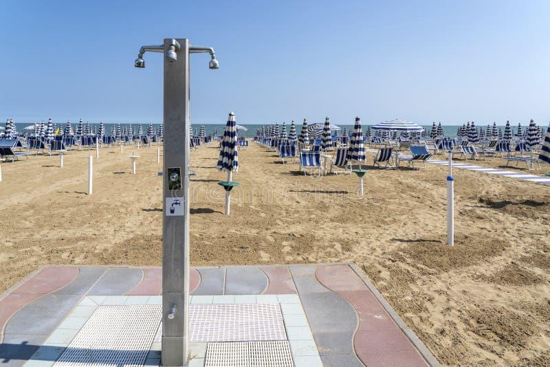 LIDO DI JESOLO, ITALY: Umbrellas on the beach of Lido di Jesolo at adriatic Sea in a beautiful summer day, Italy. On the beach of. Lido di Jesolo near Venice stock images