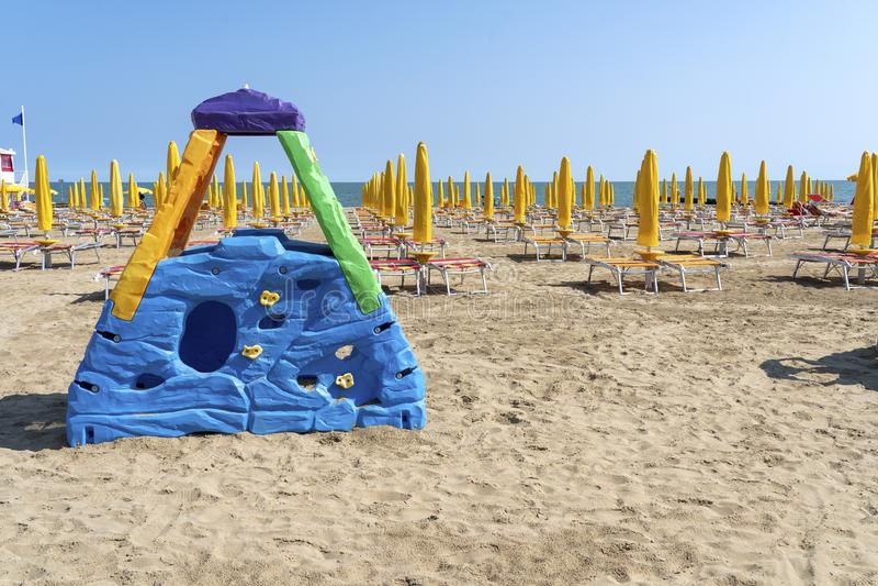 LIDO DI JESOLO, ITALY: Umbrellas on the beach of Lido di Jesolo at adriatic Sea in a beautiful summer day, Italy. On the beach of. Lido di Jesolo near Venice royalty free stock image
