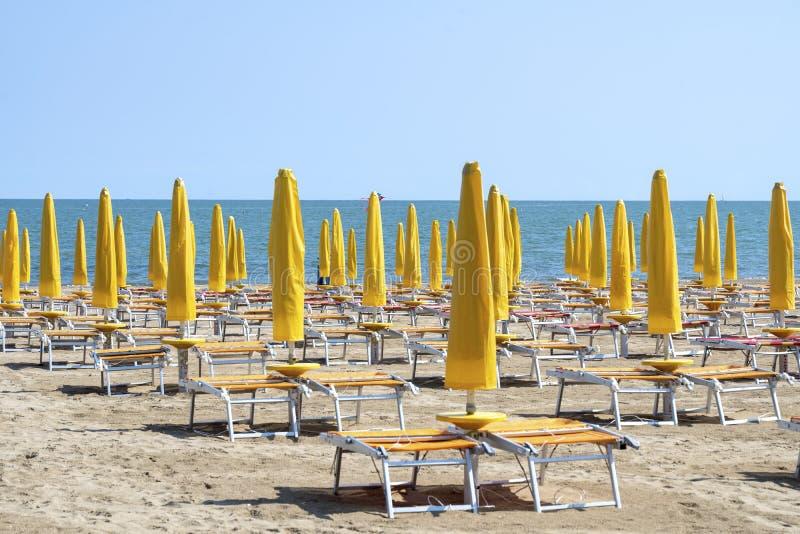 LIDO DI JESOLO, ITALY: Umbrellas on the beach of Lido di Jesolo at adriatic Sea in a beautiful summer day, Italy. On the beach of. Lido di Jesolo near Venice royalty free stock photos