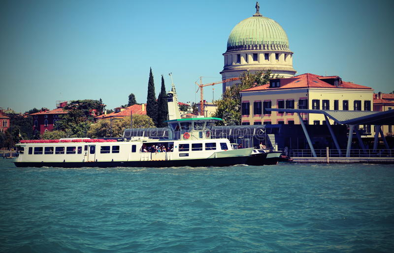 Lido of Venice in Italy and the passenger ferry boat on a hot da stock images