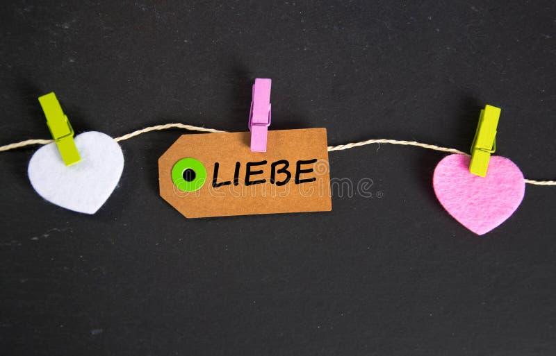 Liebe - det tyska ordet för förälskelse arkivfoton