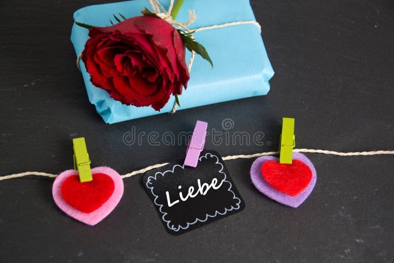 Liebe - det tyska ordet för förälskelse royaltyfri bild